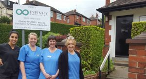Infinity dental clinic team sign